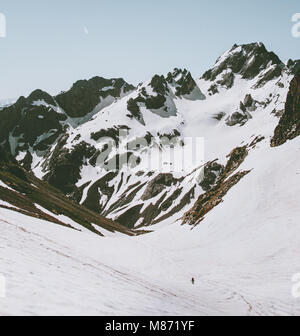 Rocky Mountains and climber man on glacier Landscape Travel adventure concept vacations getaway outdoor - Stock Photo