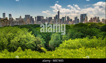 Looking over the trees of Central Park towards the skyscrapers of Manhattan from The Roof terrace at The Metropolitan - Stock Photo