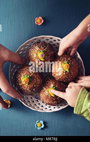 family treats with cupcakes - Stock Photo