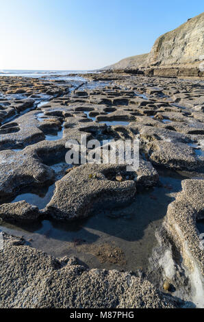 Tidal Pools in  the rock formations along Dunraven Bay, in Southerndown, South Wales - Stock Photo