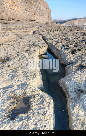 A Tidal Pool in a long crack along the shoreline of Dunraven Bay in Southerndown, South Wales - Stock Photo