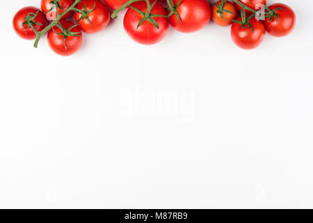 Tomato on the white background. Healthy food. Tomatoes on white background. Top view. Copy space - Stock Photo