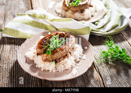 Sausage and sour turnips on rustic background - Stock Photo
