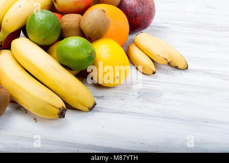 Variety of fresh citrus fruits on white background from slices of kiwi and orange ,copy space - Stock Photo