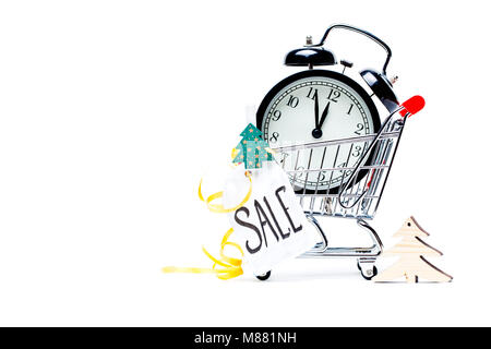 Image of trolley with golden alarm clock, Christmas tree, greeting card, ribbon - Stock Photo