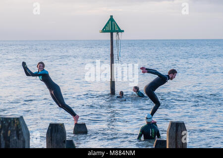 Aberystwyth Wales UK, Thursday  15 March 2018  UK Weather:   At dusk on a mild and calm March day, a group of your - Stock Photo