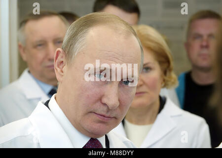 St. Petersburg, Russia. 16 March 2018,Russian President Vladimir Putin speaks to employees of the Almasov National - Stock Photo