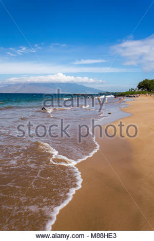 Gentle surf on Kamaole Beach Park 3 in Kihei on the island of Maui in the state of Hawaii USA - Stock Photo
