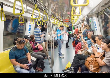 Carriage interior on Singapore Mass Rapid Transit (MRT), Serangoon, North-East Region, Singapore - Stock Photo
