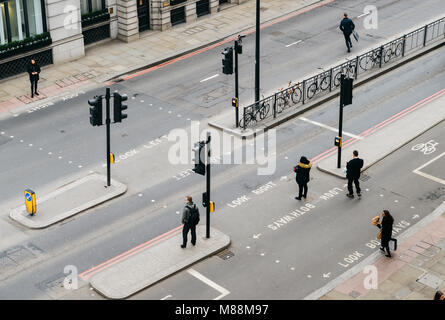London, United Kingdom- March 13, 2018: High perspective view of officer worker pedestrians in the City of London - Stock Photo
