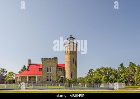 Old Mackinac Point Lighthouse first had its light displayed on October 25, 1892.  It was in operation until 1958. - Stock Photo