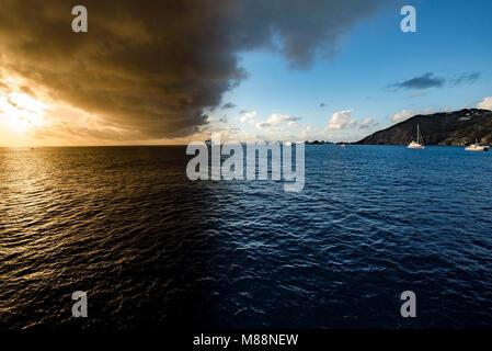 Sunset off the coast of Gustavia, St. Barts - Stock Photo