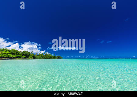 Vibrant tropical beach lagoon on north side of Upolu, Samoa Islands - Stock Photo
