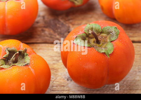 Fresh ripe persimmon with water drops. Selective focus - Stock Photo