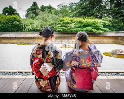 Japanese women looking at the garden