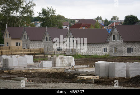 Residential area with newly built houses in a row - Stock Photo