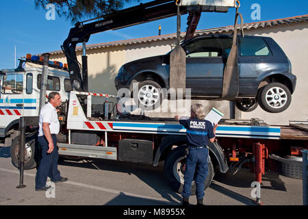 Tow of a parking violator at harbour of Saint-Tropez, french riviera, South France, Cote d'Azur, France, Europe - Stock Photo
