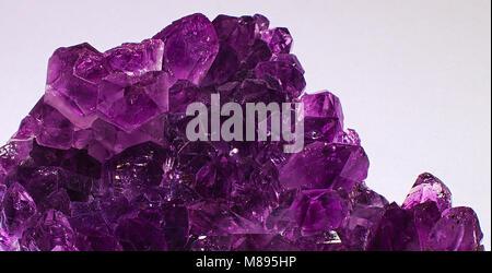 Purple crystal mineral amethyst stone - Stock Photo
