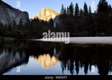 CA02894-00...CALIFORNIA - Sunset on Half Dome reflected on the Merced River in Yosemite National Park. - Stock Photo