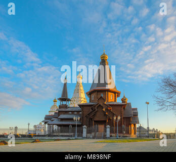 Minsk, Belarus - April 18, 2017: Wooden Trinity Church and Memorial Church of All Saints in Minsk at Dawn - Stock Photo