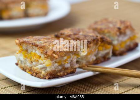 Chinese style homemade deep fried yam pumpkin cake - Stock Photo