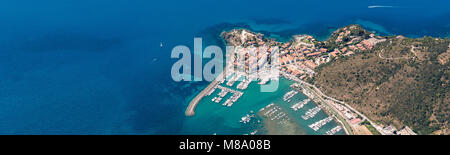 Aerial image of the beautiful town and small port of Talamone at the Tuscany Mediterranean coast in Italy - Stock Photo