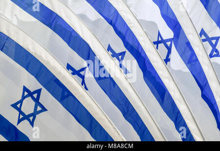 Set of five Israeli flags blowing in the wind - Stock Photo