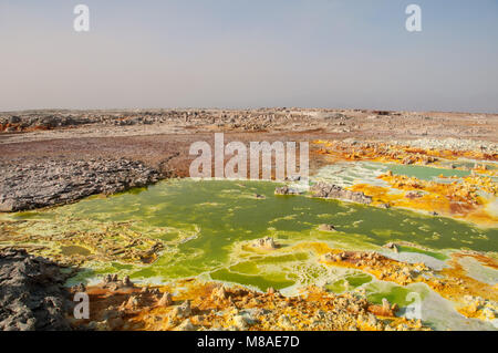 Huge green field with yellow spots of lava sulfuric volcanoes, the desert of Danakil, the Afar Basin, the North - Stock Photo
