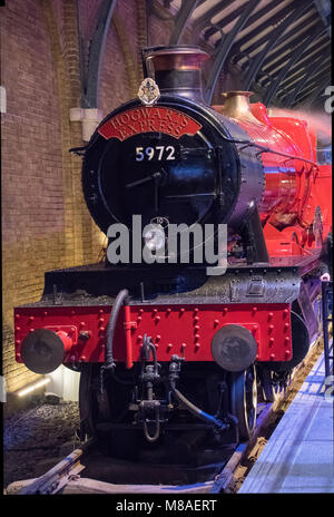 LEAVESDEN, UK - FEBRUARY 24TH 2018: Hogwarts Express steam train at the Making of Harry Potter tour at Warner Bros studio in Leavesden, UK
