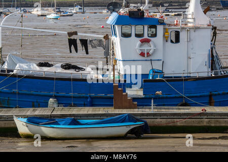 an old fishing trawler being used as a houseboat in the harbour at bembridge on the isle of wight with washing and - Stock Photo