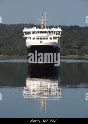 Caledonian MacBrayne's MV Finlaggan arriving at the Kennacraig Ferry Terminal on the Kintyre Peninsula in Argyll - Stock Photo