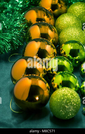 Christmas toys of different colors of balloons, gifts, reindeer mask on dark background, Christmas - Stock Photo