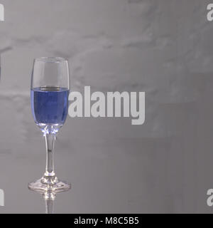 champagne in wineglasses on a blue background. - Stock Photo