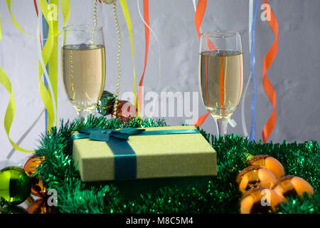 Christmas collage with gifts, champagne, toys and fir tree branches. New Year background - Stock Photo