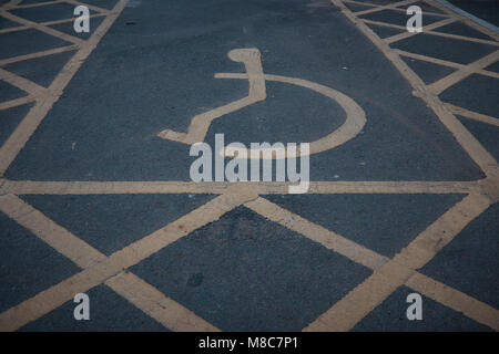 Handicapped disabled icon sign on parking area in car park . - Stock Photo