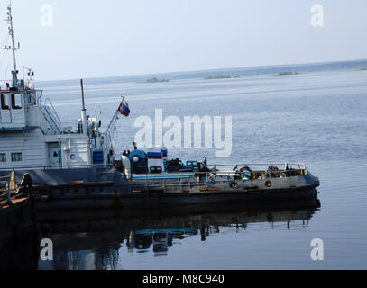 the Tug boat floats on the river - Stock Photo