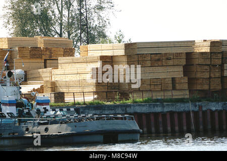 Timber is ready for shipping at a dock, Island, - Stock Photo
