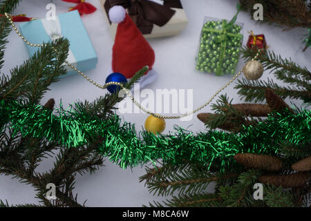 Toy car carrying a Christmas gift in a snowy landscape - Stock Photo
