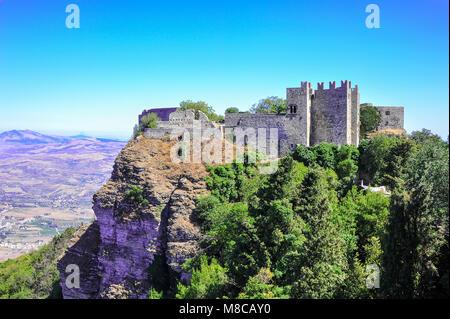 Castello di Venere (Castle of Venus), perches on top Mount Erice, Sicily. Ancient Norman ruins on a green mountainside - Stock Photo