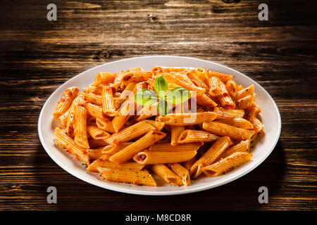 Penne with pesto sauce - Stock Photo