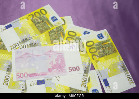 Various Euro banknotes of 200 and 500 Euro banknotes in a continuous layer - Stock Photo