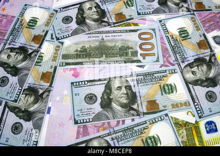 The background of the many currencies the Euro (EUR) with 500, 200, 100 dollars and euros banknotes. A lot of money. - Stock Photo