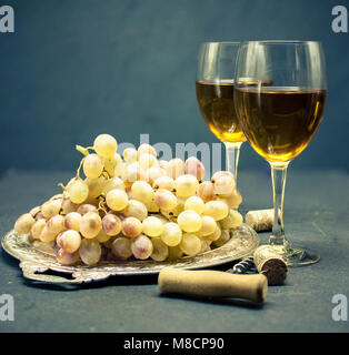 White dry wine. Two glasses of wine against a dark background. Alcoholic beverages background. House wine-making - Stock Photo