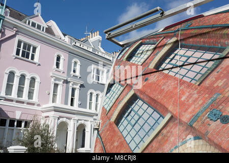 The design on the rear doors of a bespoke window company's van and Victorian houses along Elgin Crescent W11 in - Stock Photo