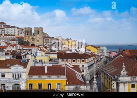 Lisbon Alfama district, looking over rooftops to cathedral - Stock Photo