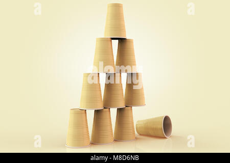 3D rendering of plastic cups stacked in a pyramid with one fallen down representing the concept of failure at teamwork. - Stock Photo
