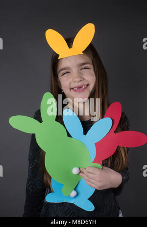 happy young girl wearing bunny ears - Stock Photo