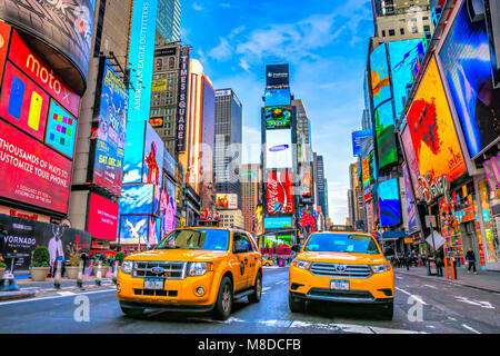 NEW YORK CITY, USA - DECEMBER 01, 2013: Times Square,is a busy tourist intersection of neon art and commerce and is an iconic street of New York City  Stock Photo