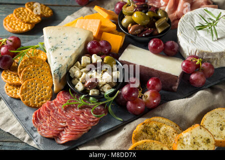 Gourmet Fancy Charcuterie Board with Meat Cheese and Grapes - Stock Photo