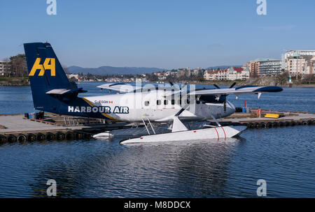 A twin engine DHC-6 DeHavilland Twin Otter floatplane operated by Harbour Air at the Victoria Inner Harbour Airport - Stock Photo